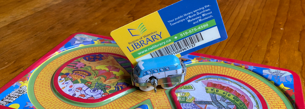 Image of library card and toy