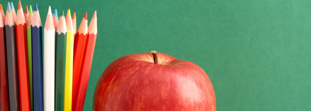 pencil crayons and an apple