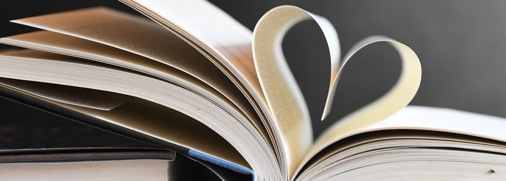 book with pages folded into heart shape